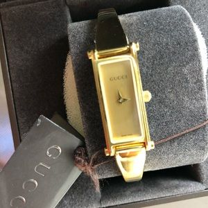 Gucci watch gold tone bangle design watch